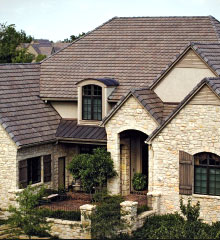A stone venere house with several different roof styles